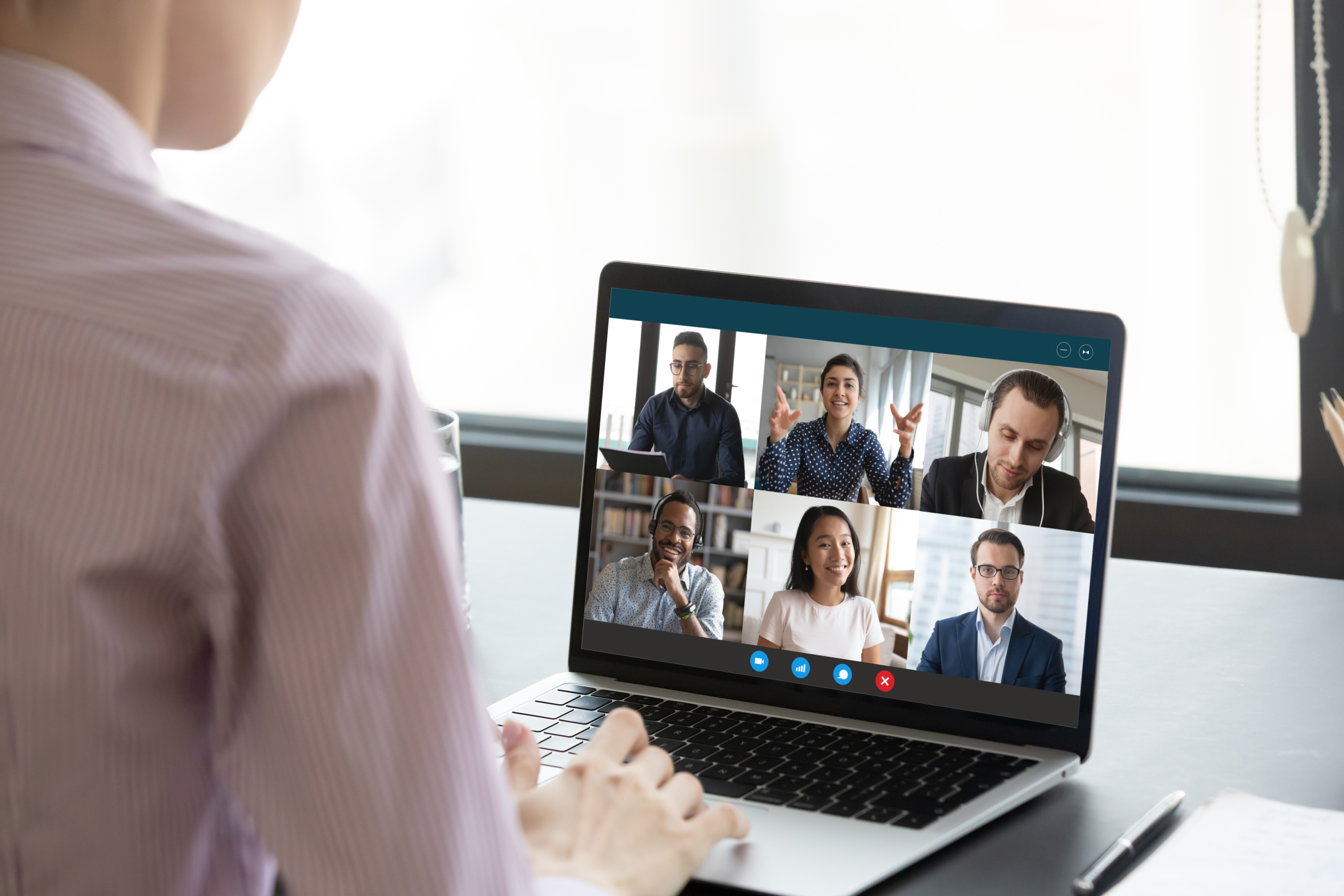 Computer screen view during group video call with multiethnic colleagues